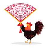 Hahn, der Papercut-Fan, Chinesisches Neujahrsfest hält Stockfoto