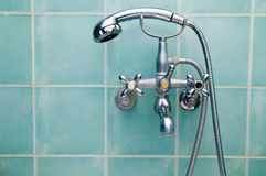 Hahn und Dusche Stockfotografie