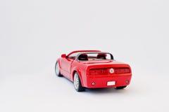 Hai Ukraina, Marzec, - 1, 2017: Mini kopia czerwieni zabawka samochodowy Ford Musi Fotografia Royalty Free