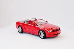 Hai Ukraina, Marzec, - 1, 2017: Mini kopia czerwieni zabawka samochodowy Ford Musi Zdjęcie Stock