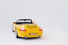 Hai Ukraina, Marzec, - 1, 2017: Mini kopia kolor żółty zabawki samochód Porsch Zdjęcie Royalty Free