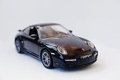 Hai Ukraina, Marzec, - 1, 2017: Mini kopia zabawkarski samochodowy Porsche GT2 ja Fotografia Royalty Free