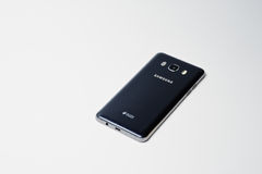 Hai, Ukraine - August 10, 2017: black Samsung smartphone laying. On the white surface Royalty Free Stock Photos