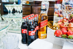 Hai, Ukraine - October 25, 2016: Coca Cola bottle with Red Label. Whiskey on buffet table royalty free stock photography