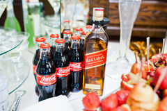 Hai, Ukraine - October 25, 2016: Coca Cola bottle with Red Label. Whiskey on buffet table royalty free stock photo