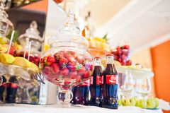 Hai, Ukraine - October 25, 2016: Coca Cola bottle with strawberries on the buffet table stock images