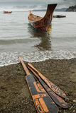 Haida Canoe and Paddles. Royalty Free Stock Image