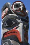 Haida Totem Pole. The top of a Haida totem pole with a hawk moon and eagle Stock Image