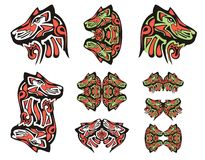 Haida wolf head tattoos. Tribal double symbols of the wolf head executed in black, red and green color Royalty Free Stock Photo