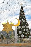 Christmas tree, Hanukkah menorah and crescent in Haifa, Israel royalty free stock images