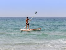 Athlete training on kayak summer morning on Mediterranean Sea near the coast of Haifa, Israel Stock Image