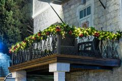 Decoratively decorated  for Christmas celebrations balcony on the Sderot Ben Gurion street in Haifa in Israel. Haifa, Israel, December 08, 2017 : Decoratively Stock Image