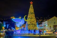 Holidays in Haifa. HAIFA, ISRAEL - DECEMBER 13, 2017: The German Colony, decorated for the holidays, with a Christmas tree, Hanukkah Menorah in Peace Dove form