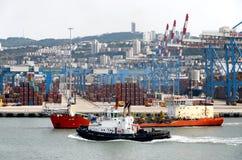 HAIFA - MAY 19 Cruise ship of Mano company, Israel. Industrial zone  19.05.2013 Patrol boats and containers Stock Photos