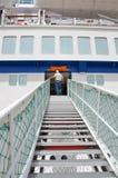 HAIFA - MAY 19 Cruise ship of Mano Сruise company. A male passenger, climbing a board Royalty Free Stock Image