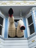 Haight-Ashbury, comic female legs with tights and red heels through window in a blue house - San Francisco, California, CA Stock Images