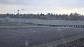 Hail on Barren Roads. Small hail falling and blowing in the wind down the street stock video