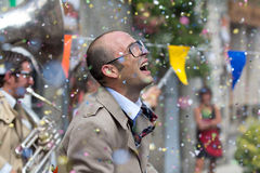 Hail of confetti on an actor. Stock Photo