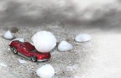 Hail Damage. A rd car damaged by large hail