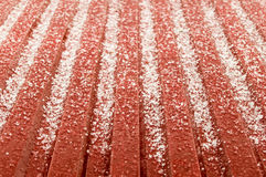 Hail ice rain on a red corrugated tin roof Stock Image