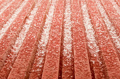 Hail ice rain on a red corrugated tin roof variant Stock Photos