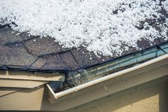 Hail on the Roof. Small Melting Hail on the Roof. Severe Weather Concept royalty free stock photo