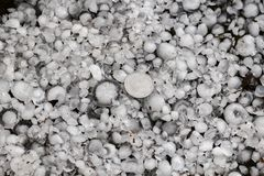 Hail sized with a larger coin, hailstones on the ground after hailstorm. Hail of great size stock images