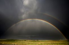 Hail Storm and Rainbow Stock Images