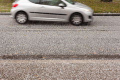 Hail Storm on the Road. Small car driving on road through heavy hail storm Stock Images