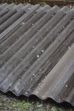 Hail and water drops on plate of grey roofing slate. Russia, Siberia Royalty Free Stock Photos