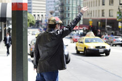 Hailing a taxi cab Royalty Free Stock Photos