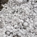 Hailstones on the ground after hailstorm, hail of great size, hail sized with a larger coin royalty free stock images