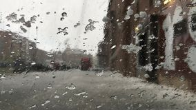 Hailstones on windscreen. In winter, storm, rain water, nature and weather concept video in 4k stock footage