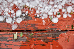 Hailstones on wood Stock Photography
