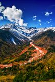 Hailuogou Red Stone Beach. Overlooking Hailuogou Conch Gully National Glacier Forest Park. Mount Gongga is high 7556m, is the highest mountain in Sichuan, China Royalty Free Stock Images