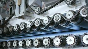 сhain sprockets in industry, cogwheels machinery, work