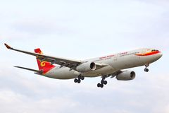 Hainan Airlines Airbus A330. BERLIN, GERMANY - AUGUST 17, 2014: Hainan Airlines Airbus A330 arrives to the Tegel International Airport Stock Images