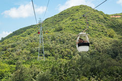 HAINAN, CHINA - 12.09.2016: Tourist going on Cable car funicular to the mountain Stock Photography