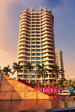 Hainan island in Shenzhou Peninsula, China - February 12, 2017: Street view at sunset with modern palace facade7: Stock Images