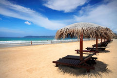 Hainan Sanya Loungers on the beach Stock Images