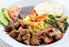 Hainan style noodle with soy sauce soup Stock Photo
