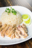 Hainanese boiled chicken rice on the wooden table Stock Photo