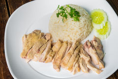 Hainanese boiled chicken rice on the wooden table Royalty Free Stock Photography