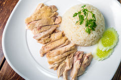 Hainanese boiled chicken rice on the wooden table Royalty Free Stock Photo
