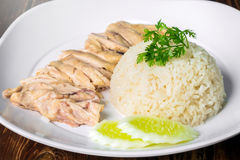 Hainanese boiled chicken rice on the wooden table Stock Images