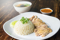 Hainanese boiled chicken rice on the wooden table Stock Photos