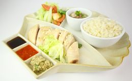 Hainanese Chicken Rice. Asia Hainanese Chicken Rice with traditional condiments Royalty Free Stock Images
