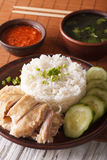 Hainanese chicken rice close-up, chili sauce and broth. vertical Royalty Free Stock Photos
