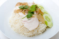 Hainanese chicken rice. Is a dish adapted from early Chinese immigrants originally from Hainan province in southern China. It is considered one of the national Stock Images