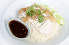 Hainanese chicken rice. Is a dish adapted from early Chinese immigrants originally from Hainan province in southern China. It is considered one of the national Royalty Free Stock Images